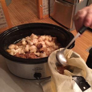 Pouring lard into jar