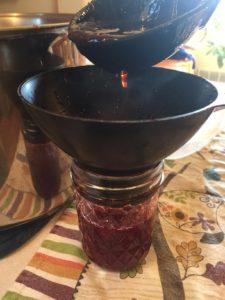 spooning jam into jar