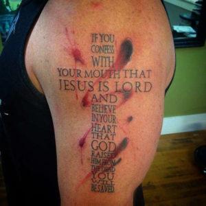 cross tattoo on arm