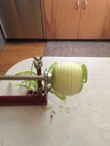 peeling an apple before dehydrating