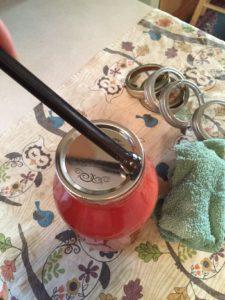 placing lid onto filled jar