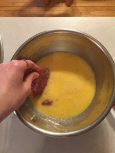 Dipping steak in egg batter
