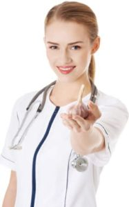 doctor holding a clove of garlic
