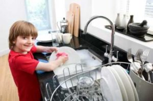 boy doing dishes