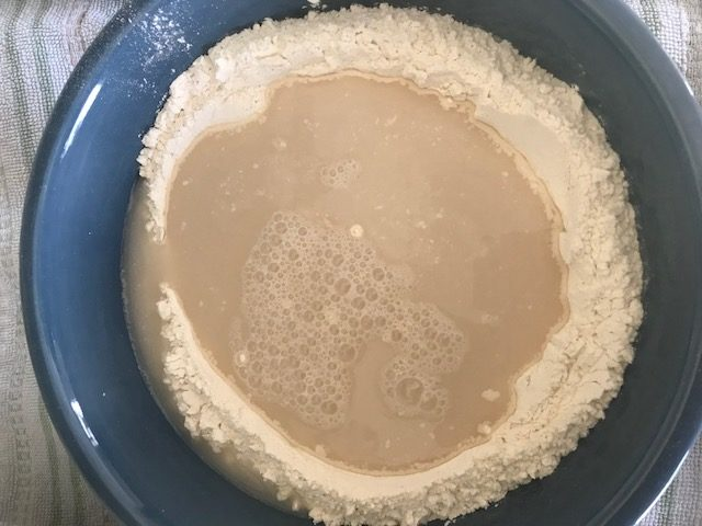 yeast mixture in flour