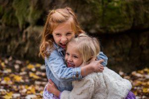 sister's hugging