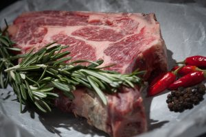 red meat has vitamin B-12 which your body needs.