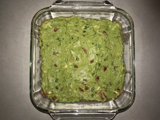 Seven-layer dip with fresh guacamole #mexicanfood #dips #heatherearles #herbnwisdom #guacamolerecipe #naturalliving #dinnerideas #podcaster #healthblogger #author