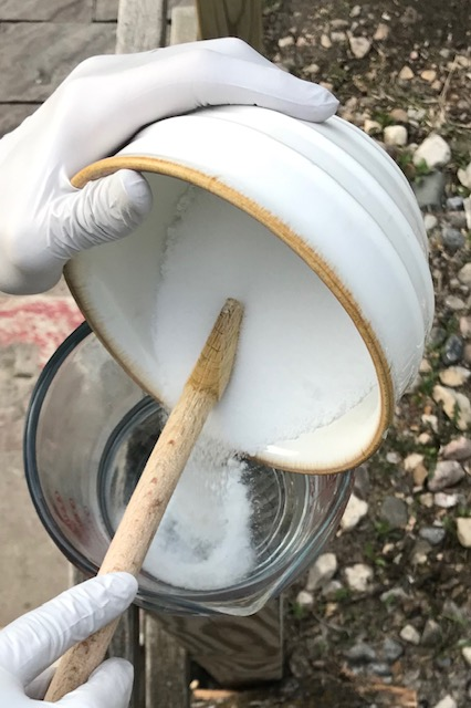 pouring the lye into the water