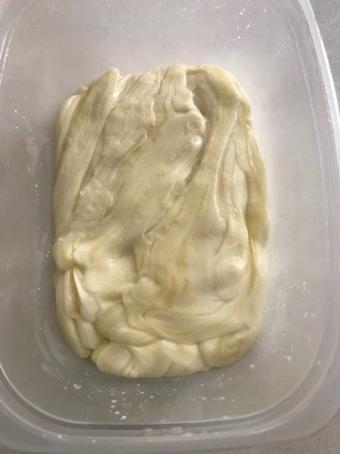 putting the stretched cheese into your choice mold