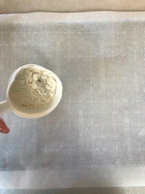 sprinkle flour onto your parchment paper