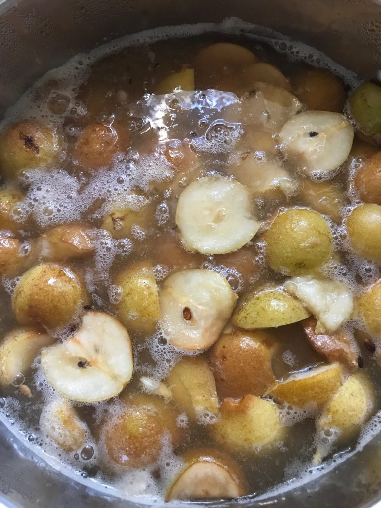 pears cooking down in a pot