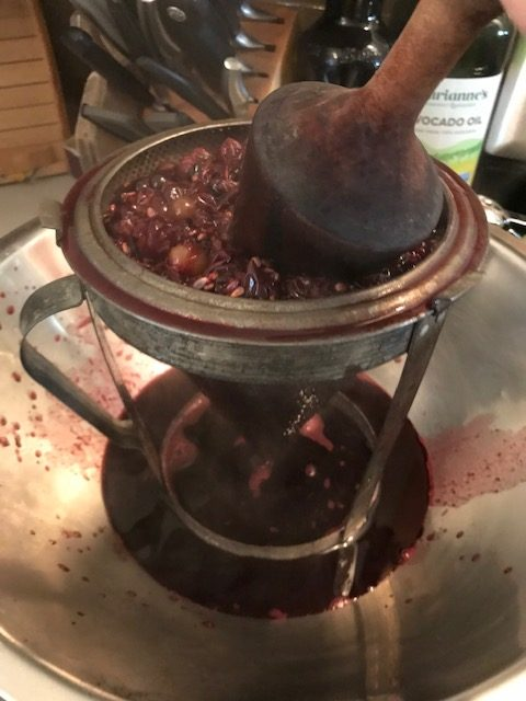 pressing the grapes