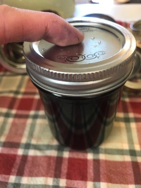 putting the lid and ring on the jar