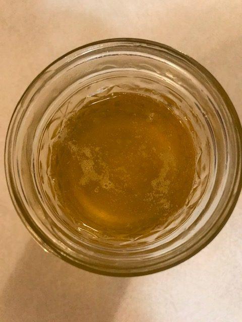 Top view of hot ghee in a jar